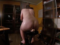 Boy is exercising on indoor bike